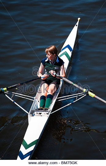 Teenage girl competing at Worcester rowing club regatta, UK. Schoolgirl in a rowing boat. - Stock Image