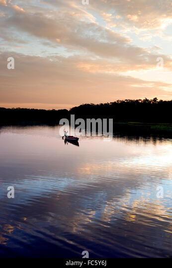 Canoe in the Amazon River in Ecuador - Stock Image