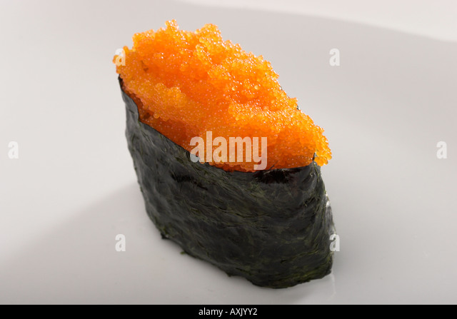tobiko sushi seaweed fish eggs food meal appetizer ethnic Asian cultural green orange fresh plants - Stock Image