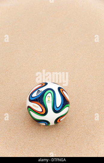 Brazuca (Replica), official matchball of FIFA World Cup 2014 in the sand - Stock-Bilder