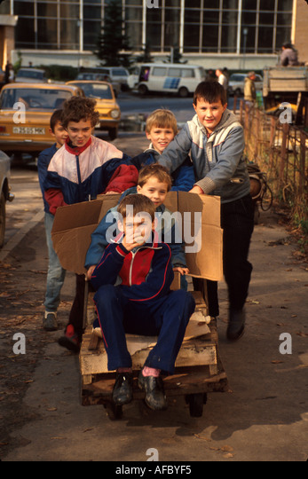 Russia former Soviet Union Moscow boys homemade gocart play near factory - Stock Image
