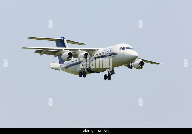 BAE146/ Avro RJ100 of the Empire Test Pilots School / QINTIQ on approach RAF Waddington Airshow 2013 - Stock Image