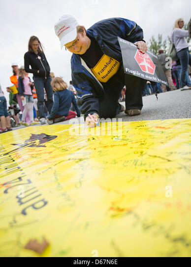 Protesters attend a demonstration against the increasing noise pollution through air traffic at the Main river in - Stock Image