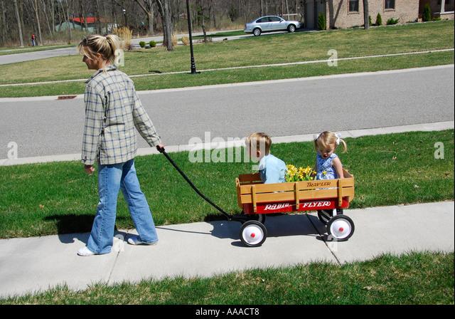 Boy Pulling Wagon : Boy pulling wagon stock photos
