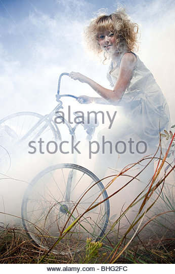 Girl with a bicycle - Stock Image