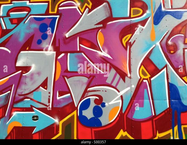 A wall of random colorful graffiti - Stock Image