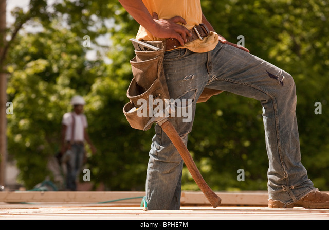 Carpenter standing at a construction site - Stock Image