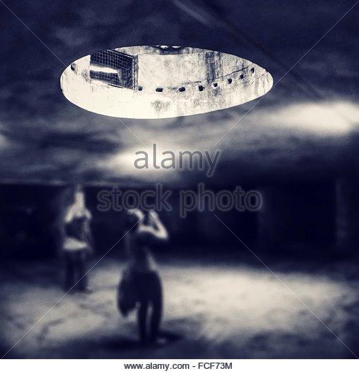 People Looking Towards Skylight - Stock Image