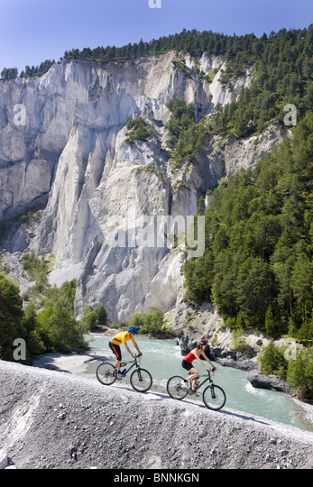 Switzerland swiss ride a bicycle Rhine gulch gulch pair couple two persons ruin alta gulch canton Graubünden - Stock Image