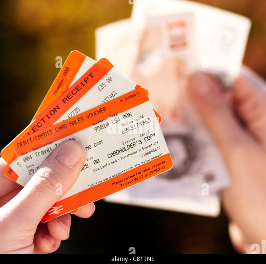 Person holding train tickets - Stock Image