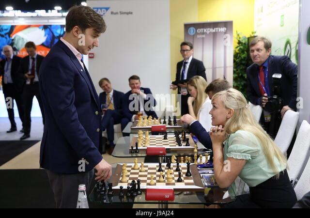St Petersburg, Russia. 1st June, 2017. Russian chess grandmaster Sergey Karjakin (L) seen during a simultaneous - Stock Image