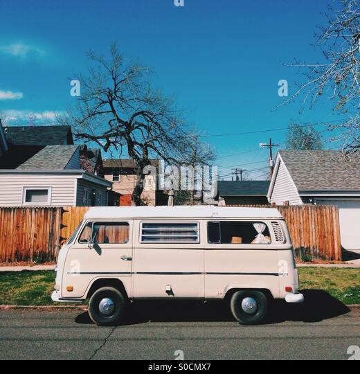VW bus in the neighborhood - Stock Image