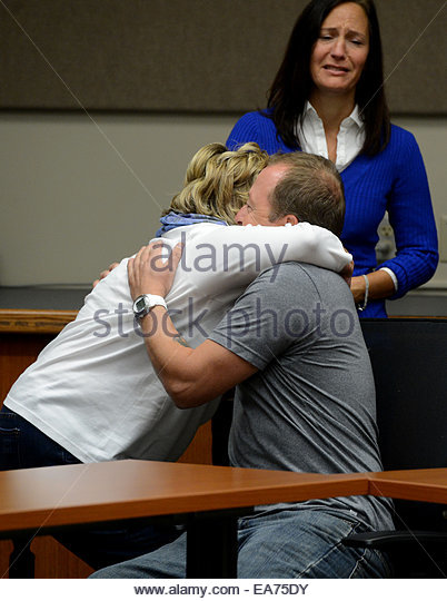 San Bernardino, California, U.S. 7th Nov, 2014. SUSAN BLAKE, mother of Joseph McStay, hugs MICHAEL MCSTAY, brother - Stock Image