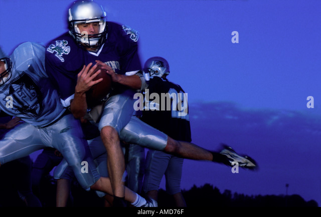 American Football Football sport sports horizontal man running with ball - Stock Image