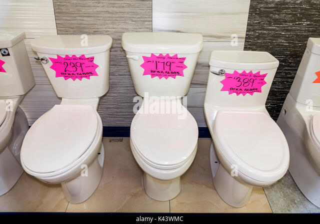Miami Florida new toilets sale display loos commodes prices after rebate - Stock Image