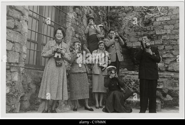Postcard of Camera Club members taking photographs of a tourist site in Sicily, Italy  - circa 1940's  1950's - Stock Image