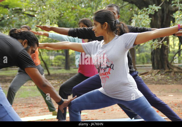 A group of Indian youngsters performing yoga in Cubbon park, Bangalore, India - Stock Image