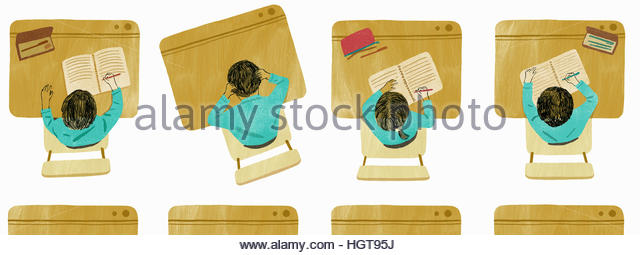 Schoolboy with head in hands sitting at slanted desk standing out in straight row of children writing in exercise - Stock-Bilder