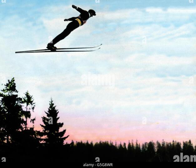 Beim Skispringen am Holmenkollen. Ski-jumping at the Holmenkollen. wintersports, ski jumping, flying, man, sportsman, - Stock Image