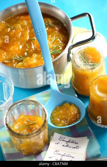 Filling the jam jars - Stock Image