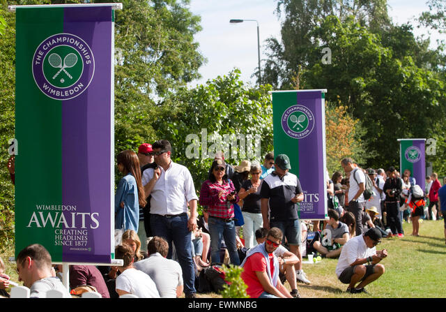 Wimbledon London,UK. 29th June 2015. Fans gather on the first day of the 2015 Wimbledon Tennis Championships as - Stock Image