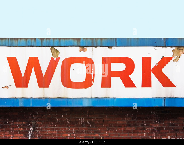 work sign mounted on building - Stock Image