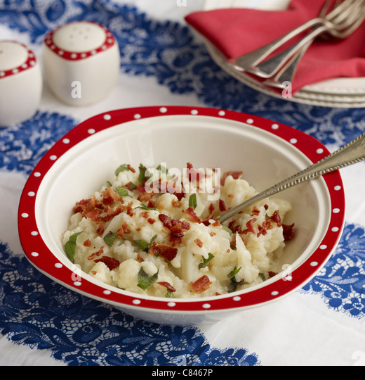 Bowl of cauliflower bacon risotto - Stock Image