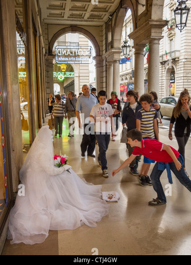 street artist in wedding dress in the center of Torino, Piedmont, Italy - Stock Image