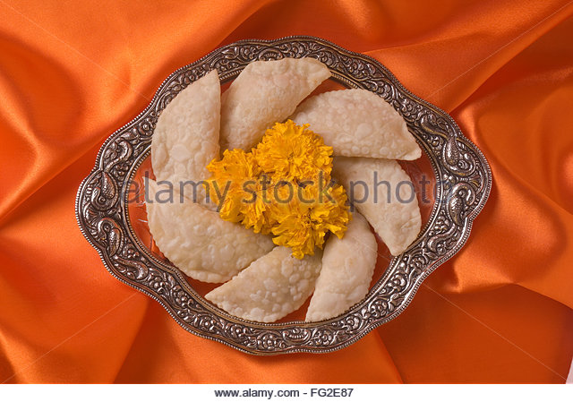 Karanji a sweet cake like stuffed eatable during Diwali deepawali festival , India - Stock Image
