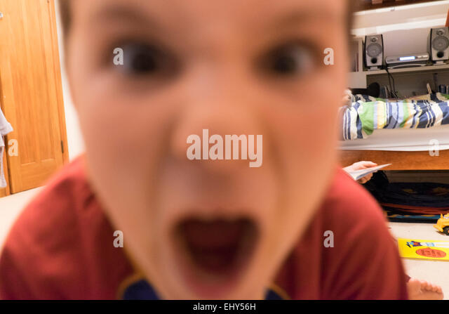 Child shouting and screaming angry emotional - Stock Image