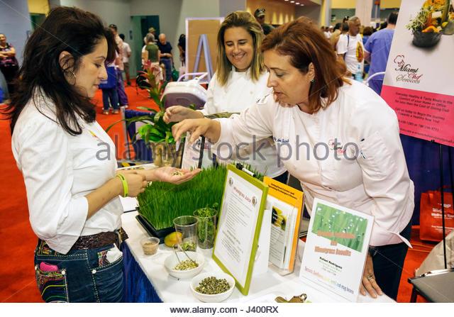 Miami Beach Miami Florida Beach Convention Center centre Health & and Fitness Expo exhibitor Hispanic woman - Stock Image