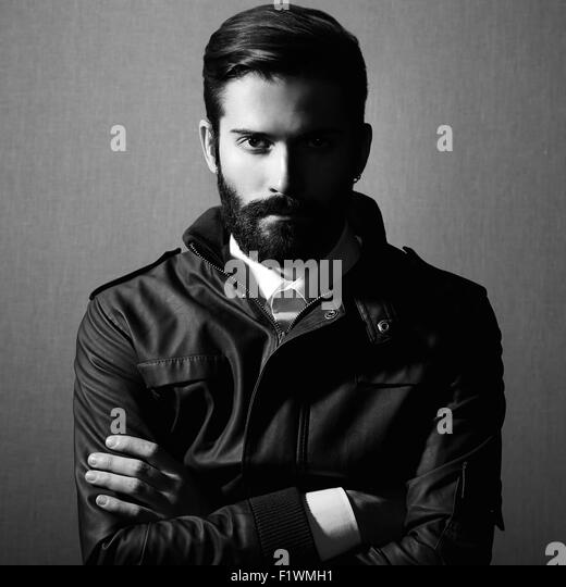 Portrait of handsome man with beard. Fashion photo. Black and white photo - Stock Image