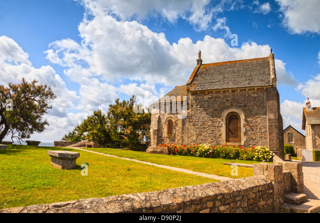 The Roman style Sailors Chapel at the small fishing port of St-Vaast-La-Hougue, Normandy, France. This was originally - Stock Image