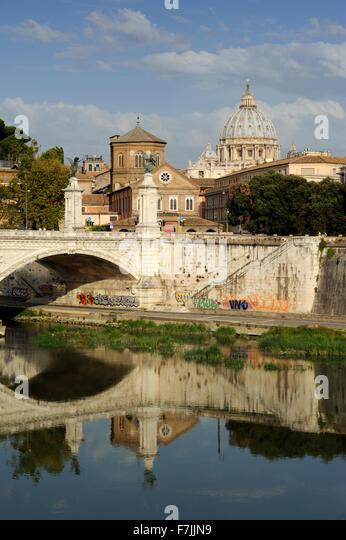 italy, rome, tiber river, ponte vittorio emanuele II bridge and st peter's basilica - Stock Image