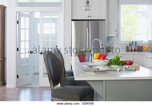 Fresh vegetables on kitchen island - Stock Image