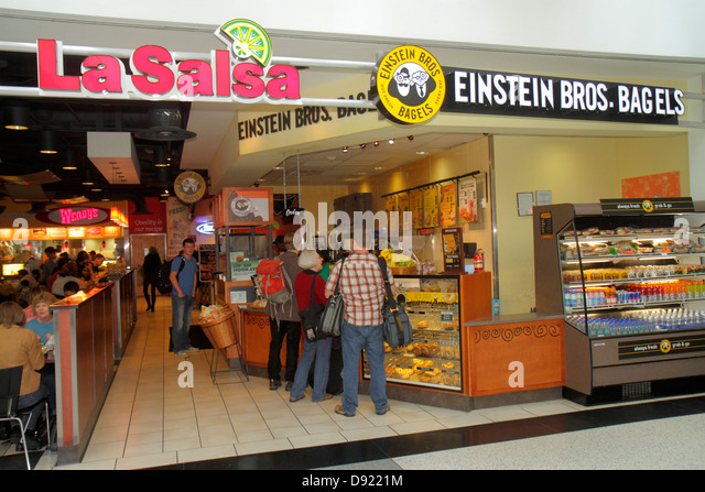 Texas Houston George Bush Intercontinental Airport IAH concourse gate area food court La Salsa Einstein Bros. Brothers - Stock Image