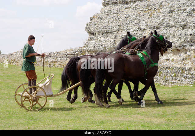 roman chariot and man dressed up as roman warrior being pulled by four horses in Kent, UK - Stock Image