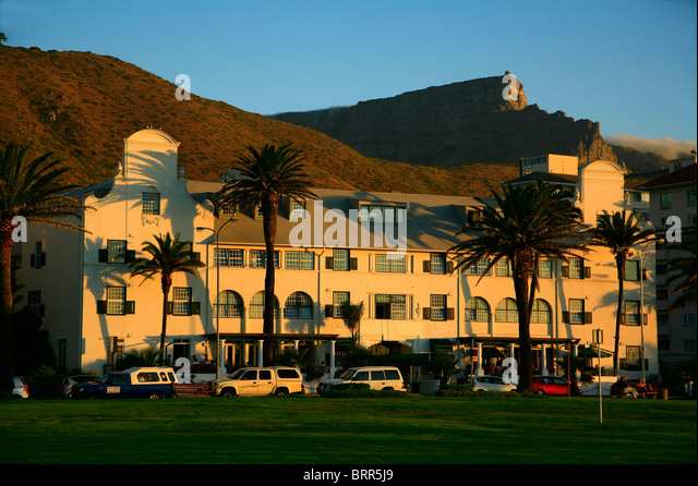 The old fashioned Winchester Mansions Hotel with palm trees and cars parked in front of it - Stock Image