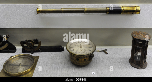 Old navigational instruments. Vintage telescope, compass, hourglass. 19th -20th centuries. - Stock Image