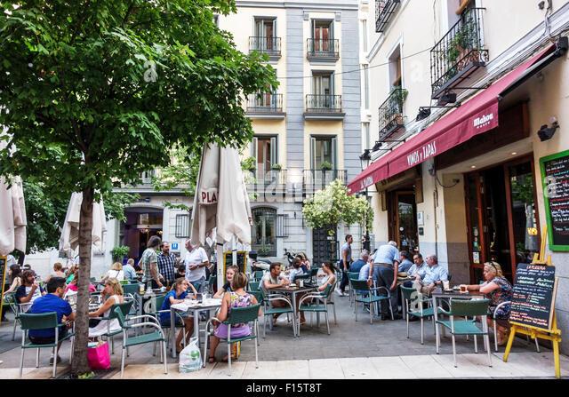 Spain Europe Spanish Madrid Centro La Plateria restaurant alfresco tables - Stock Image
