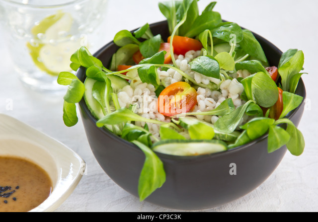 Barley and tomato salad - Stock Image