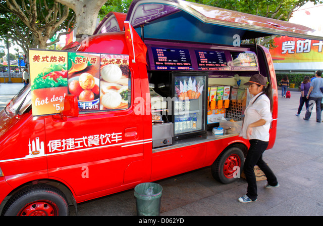 Shanghai China Pudong Lujiazui Financial District Lujiazui East Road mobile vendor snacks ice cream Mandarin symbols - Stock Image