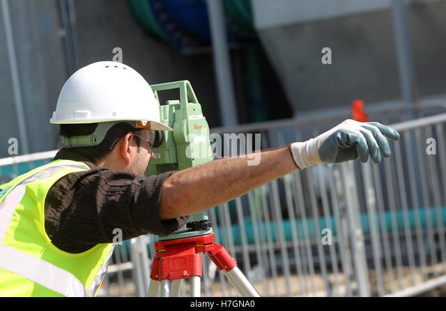 surveyor at waste water plant - Stock Image
