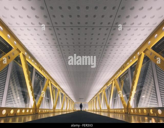 Distance Silhouette Person Walking On Bridge - Stock Image