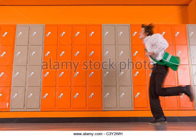 Student rushing past school lockers - Stock-Bilder