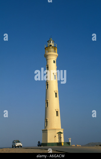 Aruba California Lighthouse car beside it for scale  caribbean tourist attraction - Stock Image
