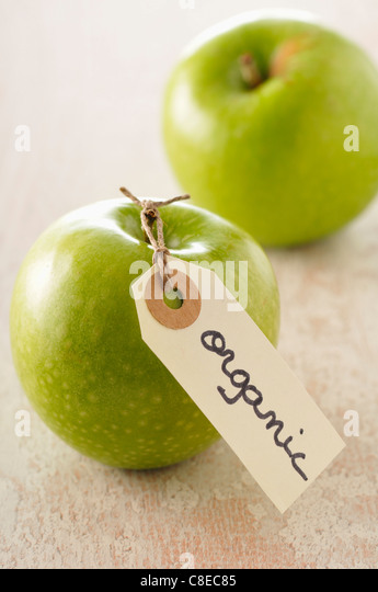 Organic Granny smith apples - Stock Image