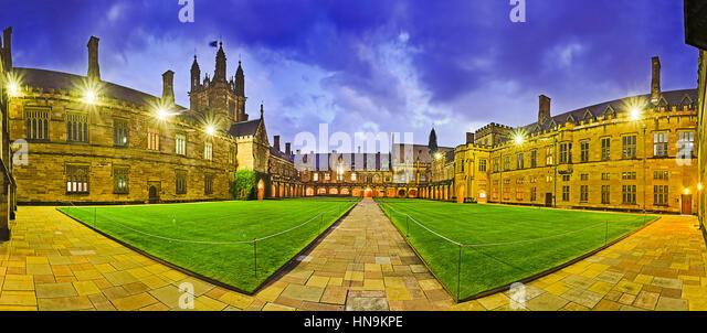 Australian tertiary education institution - university in Sydney at sunset. Panoramic courtyard of main historic - Stock Image