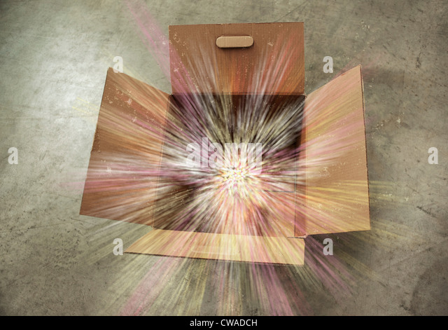 Open cardboard box with sparks - Stock Image