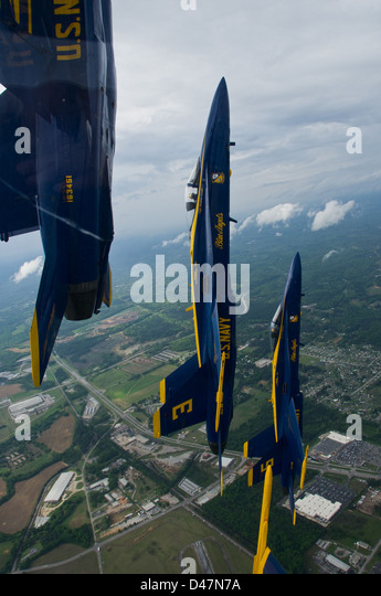 The U.S. Navy flight demonstration squadron commanding officer leads a formation. - Stock Image